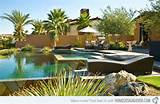 ... pool area is being landscaped with desert plants and rocks. Peterson