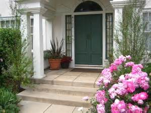 Small entry porch that frames the door Classical columns Triangular or ...