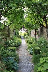 side yard cobbled path gardening pinterest
