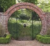 spider-garden-gate-web-hoveton-hall-gardens.jpg