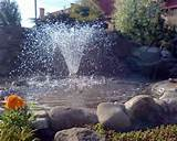 outdoor fountain with a boarder made of natural stones is one of