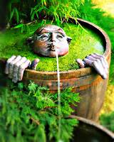 alternative gardning whimsical fountain for your garden