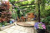photo of garden garden room with plants and chairs table al fresco ...
