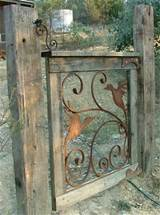 gate with timber frame rusty scrolls and bird cut outs christmas
