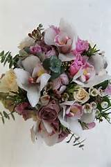 roses cymbidium orchids wax flower hydrangeas italian rosemary and