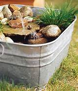 simple fountain. Spotted on: Canadian Gardening.