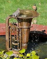 Upcycled water fountain photo via Heartland Gardens