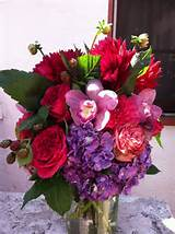 ... with dahlias, garden roses, hydrangea and cymbidium orchid blooms