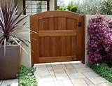 garden wooden gate archtop attached to stucco wall using clear cedar