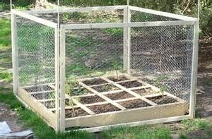 square foot gardening raised planter with wooden chicken wire fence