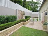 garden design using grass with retaining wall & cubby house - Gardens ...