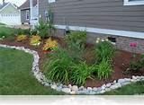 simple rock garden ideas with white river stone border