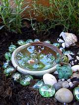 fairy pond made from ceramic bowl with frogs stones and vase gems