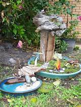 fairy garden and fairy pond connected by a bark bridge