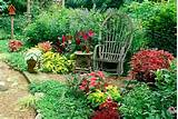 bent willow chair sits in garden of red and purple summer midwest usa