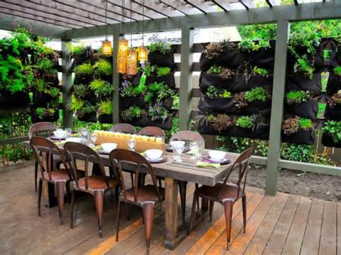 style metal dining table on this outdoor oasis with garden herb wall