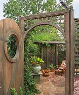 secret garden on urban plot beer garden with hops vine, arched doorway ...