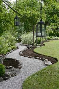 ... any snow. A crushed stone or gravel pathway bordered by larger rocks