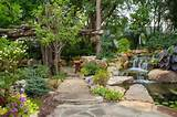garden path design ideas natural stone waterfall flowers trees walkway