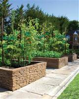 Bradstone Madoc Wall Used As A Raised Garden mediterranean-landscape