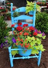 repurpose an old chair with a fresh coat of paint and use as a planter
