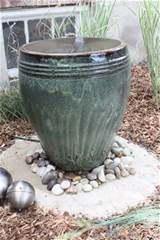 love water features! This beautiful DIY backyard fountain starts ...