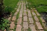 brick path use as yellow brick road in secret garden area