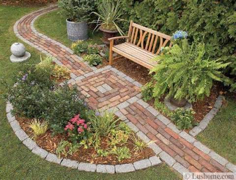 beautiful garden design with natural stone and brick walkways and