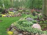 landscaping gardens shade garden hostas perennials rock garden