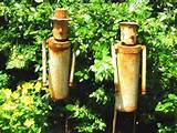 these tin men will keep the pests from your garden ok not really
