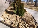landscape rock bed with river rock slicks idea