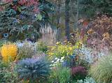 Fall perennial garden in Wisconsin. Garden art by gardener, Lark.