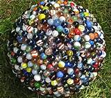 Garden sculpture: recycled marbles and bowling ball mosaic. Cracked ...
