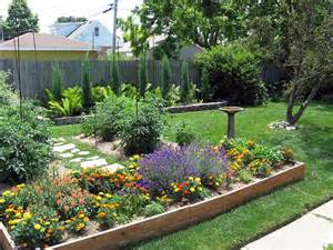 ... ) Beautiful blooms enhance this raised garden area (garden-photos