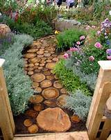 reuse an old tree to make a log pathway share if you like the idea