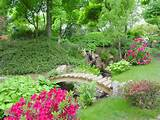 Garden Great Arch Wooden Bridge Over Small Rocky River Ideas