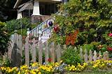 Natural looking wood picket fence amongst a flower garden