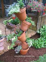 love this stacked container garden this is made by simply threading