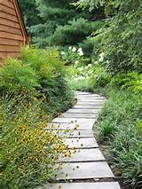 alex smith garden design stone pathway with stone arbor wall