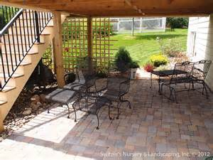 patio under deck with retaining wall steps minnesota landscaping ideas
