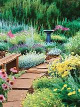 trimmed pathway with flagstone path and country garden