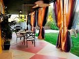 covered patio with colorful drapes multicolored drapes and low hanging ...
