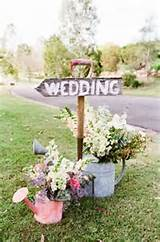 ... rustic wedding theme with beautiful flowers in can and wedding sign