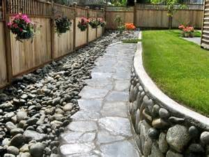 "Beautiful river rock forms a ""triple threat"" in this backyard ..."