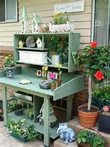 25 Cool DIY Garden Potting Table Ideas. I really like the bird houses.