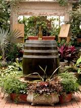 this wine barrel fountain s got a clever twist the water flows out