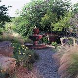 garden fountains ideas around its base are planted unthirsty plants