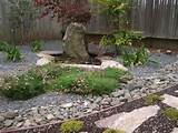 Lovely use of stone and still water in this home Japanese garden
