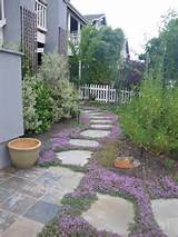 Ideas for a slope: Front lawn landscaping ideas using gravel instead ...