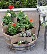 DIY recycled barrel garden pots. These container gardening ideas offer ...